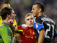 Referee Michael Kennedy breaks up a confrontation between Seattle Sounders FC forward Mike Fucito, left, and San Jose Earthquakes defender Jason Hernandez during play at CenturyLink Field in Seattle Saturday October 15, 2011. The Sounders FC won the game 2-1.