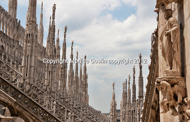 Views from the roof of the Duomo in Milan, Italy which is covered in sculptures and carved stone details