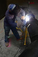 Welder applying a weld on a Steam Supply Pipe. Central Connecticut State University, New Academic Building. CT Project No: BI-RC-324. Architect: Burt Hill Kosar Rittelmann Associates. Contractor: Gilbane Building Company, Glastonbury, CT. 18 July 2012