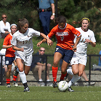 University of Virginia forward Gloria Douglas (7) dribbles forward as Boston College forward Alaina Beyar (17) and Boston College midfielder/defender Alicia Blose (13) close. Boston College defeated University of Virginia, 2-0, at the Newton Soccer Field, on September 18, 2011.