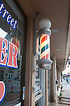 Classic, barbershop with red and blue pole by door, Carmel, Indiana, IN, USA
