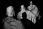 As part of their devotion to an ascetic life, Buddhist monks rise for an early-morning walk, earning their daily meals along the way by saying a prayer for those who offer them food.