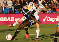 Ike Opara of Earthquakes controls the ball away from Robbie Keane of Galaxy during the game at Buck Shaw Stadium in Santa Clara, California on October 21st, 2012.  San Jose Earthquakes and Los Angeles Galaxy tied at 2-2.
