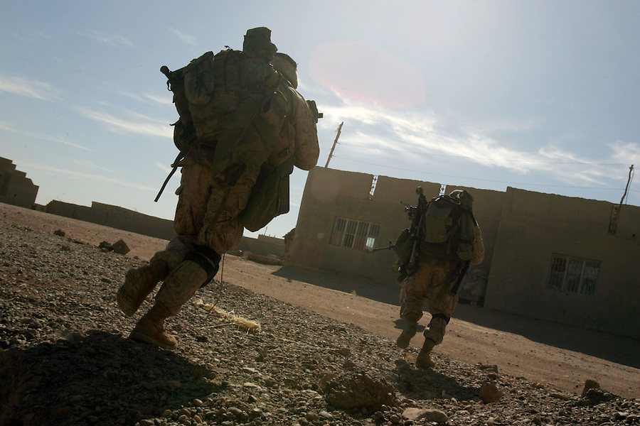 Marines from Golf Co. 2nd Battalion 1st Marines run across an exposed area during the fifth day of Operation Steel Curtain, an operation to clear Husaybah (a city on the Iraq-Syrian border) of insurgents on Wed. Nov. 9, 2005.