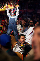 A young fan wearing a Luchador (fighter) mask. Lucha Libre is a style of wrestling started in Mexico in 1933. The name means Free Fight, and matches tend to be focussed on spectacle and theatre with fans cheering for their favourite characters, who wear masks while jumping from the ropes, flipping opponents, and occasionally crashing into the crowd..&copy;Jacob Silberberg/Panos/Felix Features.