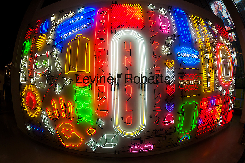Neon wall display at the Uniqlo pop-up store in Times Square in New York on Tuesday, December 6, 2016. (© Richard B. Levine)