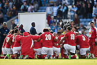 The Tonga team huddle together after the match. Rugby World Cup Pool C match between Argentina and Tonga on October 4, 2015 at Leicester City Stadium in Leicester, England. Photo by: Patrick Khachfe / Onside Images
