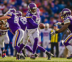19 October 2014: Minnesota Vikings quarterback Teddy Bridgewater makes a handoff to running back Jerick McKinnon in the fourth quarter against the Buffalo Bills at Ralph Wilson Stadium in Orchard Park, NY. The Bills defeated the Vikings 17-16 in a dramatic, last minute, comeback touchdown drive. Mandatory Credit: Ed Wolfstein Photo *** RAW (NEF) Image File Available ***