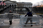 Obama Inauguration - Monday activities around the Capitol on Martin Luther King Jr. Day. Workers assemble barricades along the Parade route.