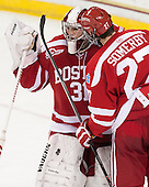 Sean Maguire (BU - 31), Doyle Somerby (BU - 27) - The Boston College Eagles defeated the visiting Boston University Terriers 6-4 (EN) on Friday, January 17, 2014, at Kelley Rink in Conte Forum in Chestnut Hill, Massachusetts.