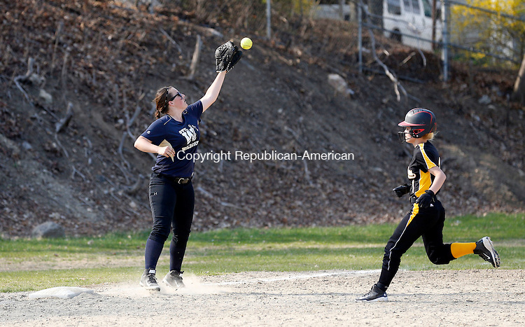 Torrington, CT- 04 May 2015-050415CM13  Kaynor Tech's Nathalie Vega picks up an extra base as she makes it to third safely, ahead of a throw to Wolcott Tech's Jenna Lemanquais during their softball matchup in Torrington on Monday.  Kaynor won,13-11.   Christopher Massa Republican-American