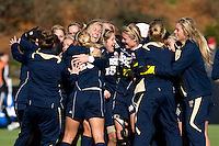 Lauren Fowlkes (9) of Notre Dame celebrates the win with teammates after the final of the NCAA Women's College Cup at WakeMed Soccer Park in Cary, NC.  Notre Dame defeated Stanford, 1-0.