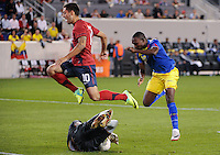 Clint Dempsey (10)  of the United States jumps over Ecuador goalkeeper Maximo Banguera (1). The men's national team of the United States (USA) Ecuador (ECU) during an international friendly at Red Bull Arena in Harrison, NJ, on October 11, 2011.