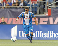 Philadelphia Union midfielder Daniel Cruz (44) on the attack.  In a Major League Soccer (MLS) match, the New England Revolution (dark blue) defeated Philadelphia Union (light blue), 5-1, at Gillette Stadium on August 25, 2013.