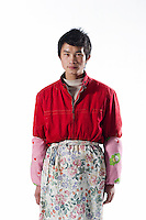 """Worker Wang Song poses for a photograph in Artissmo Designs factory in Yiwu, Zhejiang province, China, on February 14, 2012.  Wang Song, 21-year-old, from Chongqing, is the son of Xu Yuqing and Wang Congming, and works with them in the same factory: """"I am only starting to work. I am happy to be with my parents because we can support one another"""". Photo by Lucas Schifres/Pictobank"""