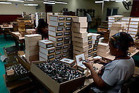 Women pack cigars at La Corona cigar factory in Havana, Cuba, March 01, 2017. Tourists from around the world visit to Cuba during the annual festival of the cigar, celebrate from February 27 to 3 of March.  VIEWpress/Eliana Aponte.