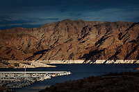 CREDIT: Daryl Peveto / LUCEO for The Wall Street Journal.Photo Assignment ID: 11416 Slug: LAKEMEAD ..Lake Mead, Nevada, March 16, 2011 - A view of the water line (wash tub effect) can be seen from Echo Bay on Lake Mead. ..Lake Mead is the largest water reservoir in the United States. Located on the Colorado River southeast of Las Vegas, it is the major reserve for Nevada, California and Arizona. The city of Las Vegas alone gets 90% of its water from Lake Mead. The lake is currently experiencing a ten year drought, recently dropping to1,083 feet - its lowest level since it was dammed in the 1930s. If it drops further, there is the potential for cutoffs of water for hydro-electricity, agriculture and cities across the Southwest. The current level is near emergency level: if drops to 1075, the Secretary of Interior will have to declare a severe water emergency and major cutbacks will ensue. If gets below 1025, all water for hydro from Hoover Dam shut off. If it falls below 1,000 feet the intake valves that pull water from the Lake for consumption will no longer be operational.