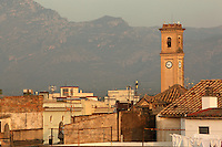Belltower of the Rosary Church, Tortosa, Tarragona, Spain. The Rosary Church or Parroquia del Rosario was built 1912-14, and its belltower is seen here above the rooftops of the old town of Tortosa with mountains in the distance. Picture by Manuel Cohen