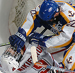 3/11/05 Omaha Neb. Lake Superior State's Mike Adamek punches University of  Nebraska at Omaha Alex Nikiforuk  during the first period of Friday night's game at the Qwest Center Omaha. University of  Nebraska at Omaha won the first game of the CCHA play-offs.(chris machian/Prarie Pixel Group)