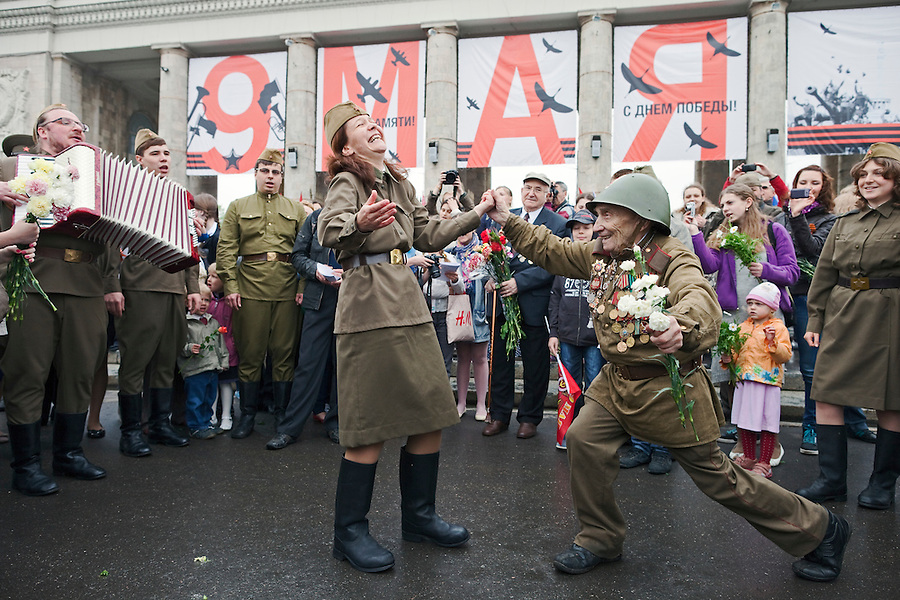 Moscow, Russia, 09/05/2012..An army veteran dancing with a woman in World War Two era Soviet uniform as Russian World War Two veterans and well-wishers gather in Gorky Park during the countrys annual Victory Day celebrations.