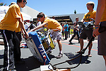 Mountain View High School robotics team member, Adrian Brandemuehl, center, lifts his teams robot as his teammates prepare to change the battery in their robot after a round of frisbee-throwing during the RoboNanza competition June 27.