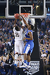 UK center Dakari Johnson (44) blocks UConn center Amida Brimah (35) shot during the NCAA Championship vs. UConn at the AT&T Stadium in Arlington, Tx., on Monday, April 7, 2014. Photo by Emily Wuetcher | Staff