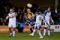 Max Clark of Bath Rugby charges down an attempted drop goal from Mike Delany of Newcastle Falcons. Aviva Premiership match, between Bath Rugby and Newcastle Falcons on March 18, 2016 at the Recreation Ground in Bath, England. Photo by: Patrick Khachfe / Onside Images