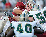 Florida State's quarterback Chris Rix (top) goes up and over the University of Alabama-Birmingham defense for a touchdown on the first series September 18, 2004 in Tallahassee.  Defending for UAB are linebacker Darrius Taylor (40) and Zac Woodfin (58). (Mark Wallheiser/TallahasseeStock.com)