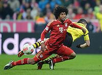 FUSSBALL   1. BUNDESLIGA  SAISON 2012/2013   15. Spieltag FC Bayern Muenchen - Borussia Dortmund     01.12.2012 Dante (vorn, FC Bayern Muenchen) gegen Robert Lewandowski (Borussia Dortmund)