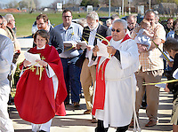 NWA Democrat-Gazette/BEN GOFF -- 03/29/15 The Rev. Pamela Morgan and The Rev. David Benham take part in a procession into the church for Palm Sunday service at St. Thomas Episcopal Church in Springdale on Sunday Mar. 29, 2015.