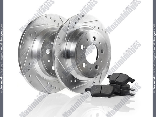 Car brake discs, rotors and break pads isolated on white background. Automotive parts still life.