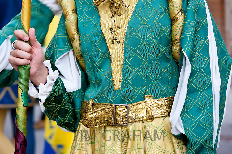 Contrada member in livery costumes for traditional parade in Asciano, inTuscany, Italy