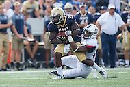 Annapolis, MD - SEPT 10, 2016: Navy Midshipmen running back Calvin Cass Jr. (20) is tackled by a Connecticut defender during their match up at Navy-Marine Corps Memorial Stadium in Annapolis, MD. Navy held on to defeat Connecticut 28-24. (Photo by Phil Peters/Media Images International)