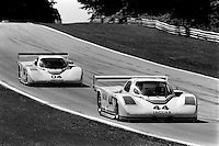ELKHART LAKE, WI - AUGUST 25: The Jaguar XJR-5 008 driven by Bob Tullius and Chip Robinson leads the Jaguar XJR-5 006 of Brian Redman and Hurley Haywood during the Löwenbräu Classic IMSA GT race at the Road America circuit near Elkhart Lake, Wisconsin, on August 25, 1985.