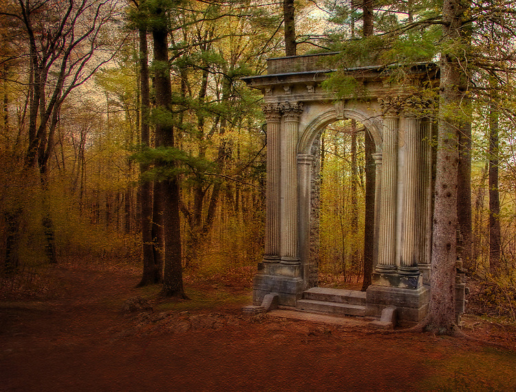 A classical arch in a woods