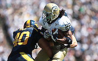 Mike Mohamed (left) and Aaron Tipoti (40) combine on Josh Reese. The University of California Berkeley Golden Bears defeated the UC Davis Aggies 52-3 in their home opener at Memorial Stadium in Berkeley, California on September 4th, 2010.