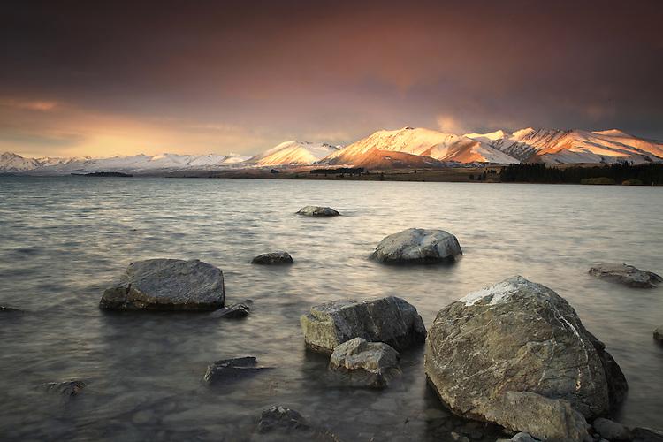 Sunset at the lakes edge, Lake Tekapo McKenzie Country, South Island, New Zealand
