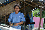 Ally de la Cruz repairs a fishing net that survived the destruction caused in the Philippines by Typhoon Haiyan in November 2013. He lives on Manipulon, a small island off the coast from the town of Estancia. The storm was known locally as Yolanda. Most of the island's boats were damaged or destroyed, and almost all the fighing nets left unusable. Residents of this island have received some assistance from the ACT Alliance.