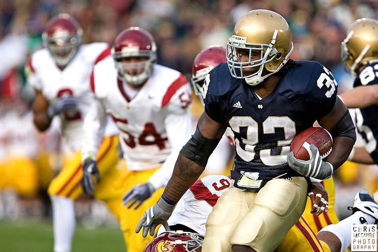 10/17/09 - South Bend, IN:  Notre Dame running back Robert Hughes fights for yards against USC during their game at Notre Dame Stadium on Saturday.  USC won the game 34-27 to extend its win streak over Notre Dame to 8 games.  Photo by Christopher McGuire.
