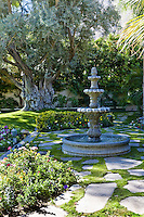 4 tier fountain seen in garden