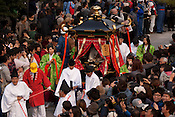 Participants carrying a portable shrine carrying a model of a deity arriving at Tagata Shrine in the Tagata Fertility Festival.