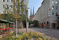 Propstrasse Platz with its cafes, and in the distance, the Nikolaikirche, built 1220-30, the oldest church in Berlin, Mitte, Berlin, Germany. Picture by Manuel Cohen