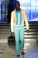 Model walks the runway in an outfit from the Francis Hendy Spring 2012 collection, during New York Fashion Spring 2012, on September 8, 2012.