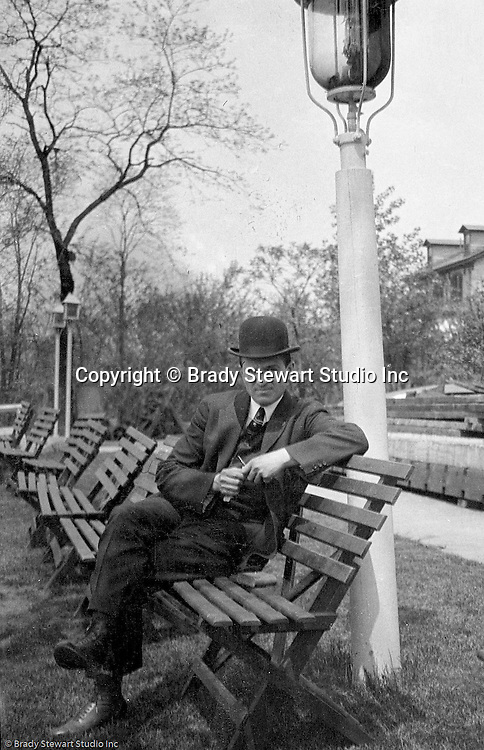 Highland Park: Brady Stewart taking a break from a stroll through Highland Park with Sarah Stewart - 1912.  During this time, Brady Stewart lived 5801 Wellesley Avenue in Highland Park not far from the park entrance.