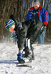 WATERBURY, CT 01 December 2008-010109SV04--Noah Yeismer, 7, of Waterbury tries out his new snowboard he got for Christmas with is dad Sam Yeismer at Fulton Park in Waterbury Thursday.<br /> Steven Valenti Republican-American