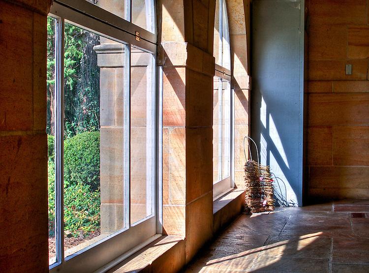 Sunlight shining through two large conservatory windows