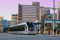 Stock photo of a Houston Metro train in front of Texas Children's Hospital