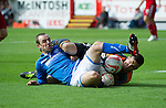 Aberdeen v St Johnstone...31.08.13      SPFL<br /> Dave Mackay and Jamie Langfield battle for the ball<br /> Picture by Graeme Hart.<br /> Copyright Perthshire Picture Agency<br /> Tel: 01738 623350  Mobile: 07990 594431