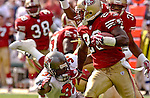 San Francisco 49ers defensive back Jimmy Williams (23) stiff-arms Tampa Bay Buccaneers defensive back Tim Wansley (31) on Sunday, October 19, 2003, in San Francisco, California. The 49ers defeated the Buccaneers 24-7.