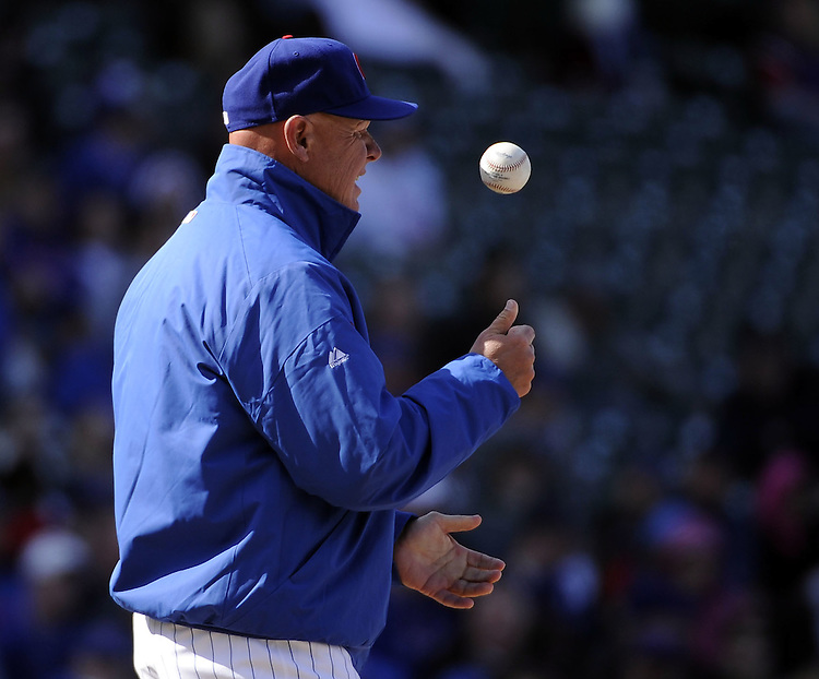 CHICAGO - APRIL  05:  Manager Mike Quade #8 of the Chicago Cubs tosses the baseball during a pitching change  against the Arizona Diamondbacks on April 5, 2011 at Wrigley Field in Chicago, Illinois.  The Cubs defeated the Diamondbacks 6-5.  (Photo by Ron Vesely) Subject: Mike Quade